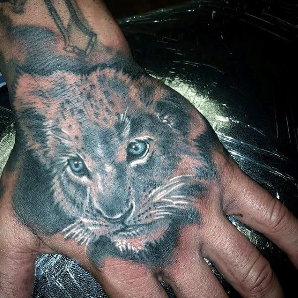 Men's Hand Young Lion Tattoos