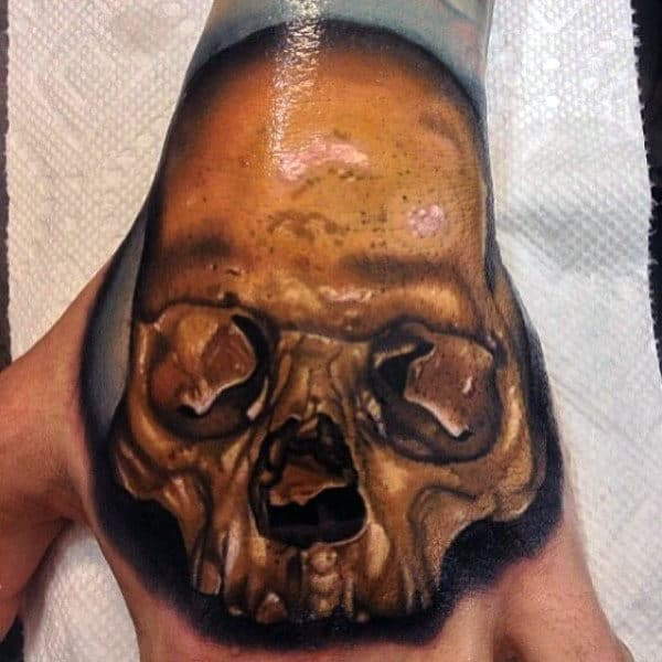 Mens Hands Interesting Golden Skull Tattoo