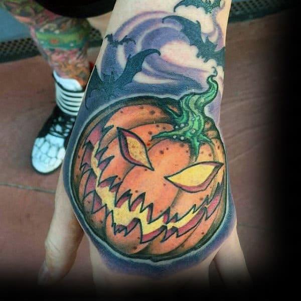 Mens Hands Yellow Halloween Pumpkin Tattoo