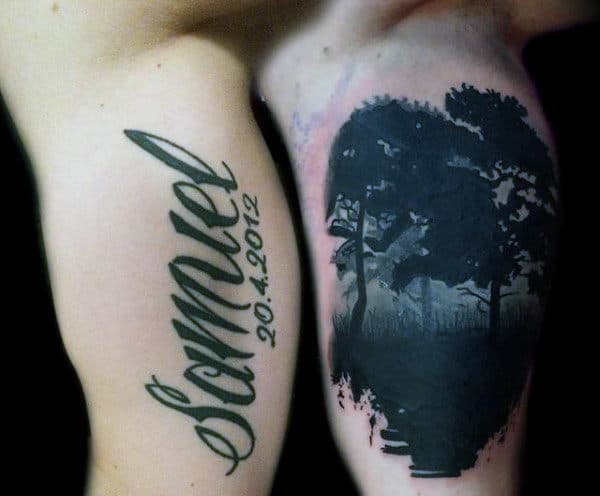 Mens Inner Biceps Dark Tree Lettering Tattoo