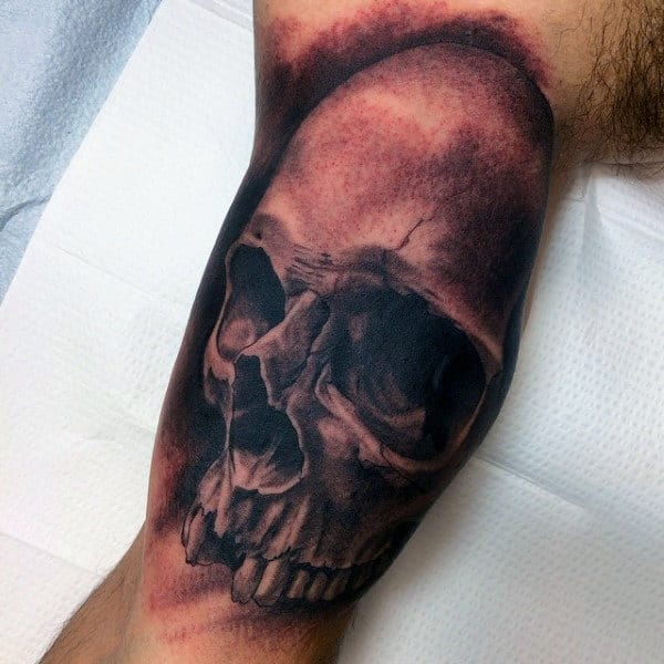 Mens Inner Biceps Large Eyed Skull Tattoo