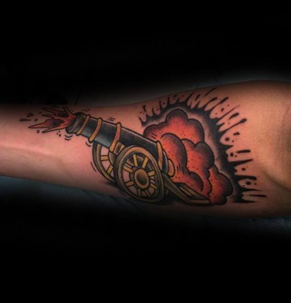 Mens Inner Forearm Blasting Cannon Tattoo Design Inspiration