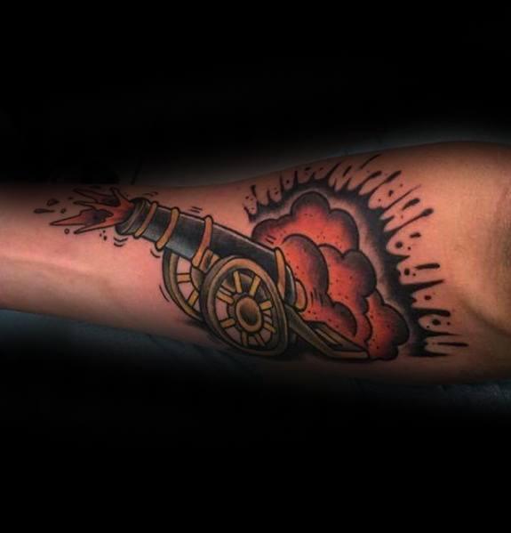 Mens Inner Forearm Blasting Cannon Tattoo Design Inspiration