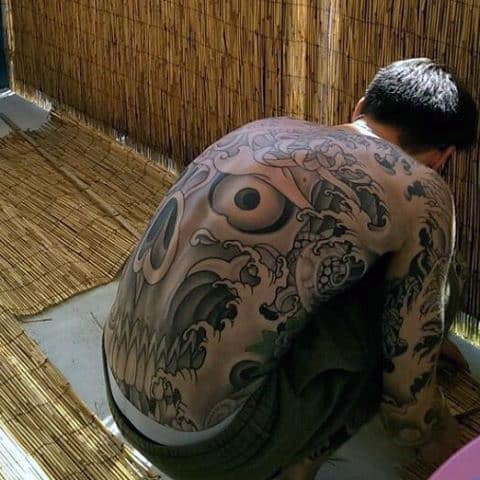 Mens Large Black Eye And Waves Tattoo Full Back