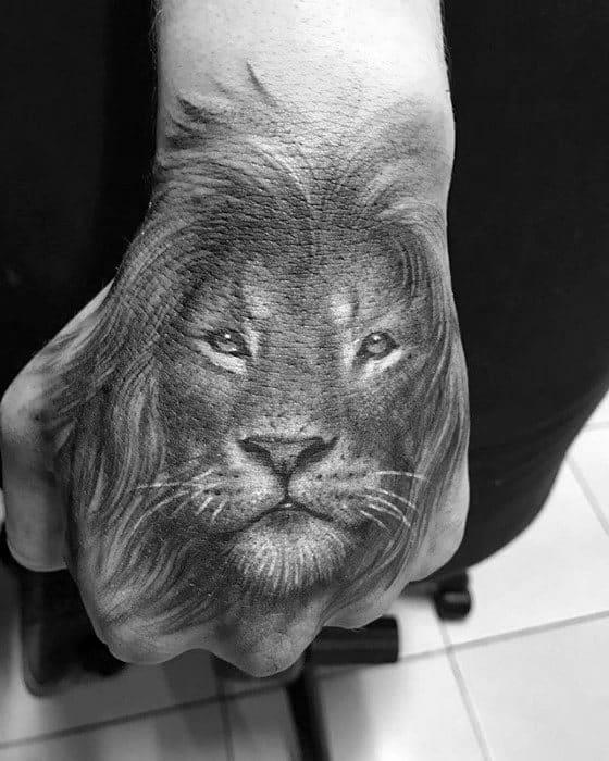 Mens Lion Hand Heavily Shaded Tattoo Ideas