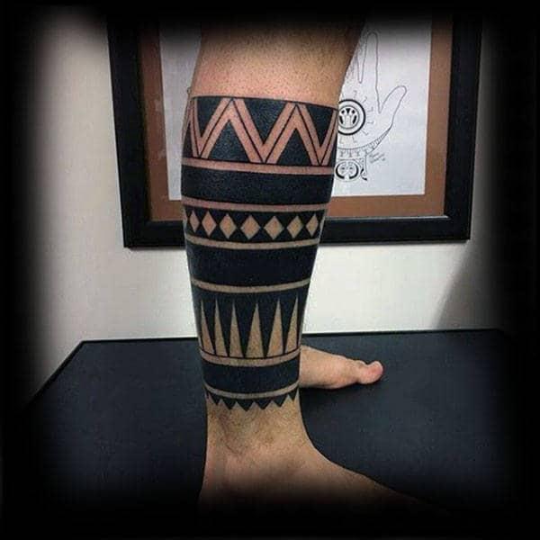 Mens Lower Leg Sleeve Tribal Negative Space Tattoo Designs