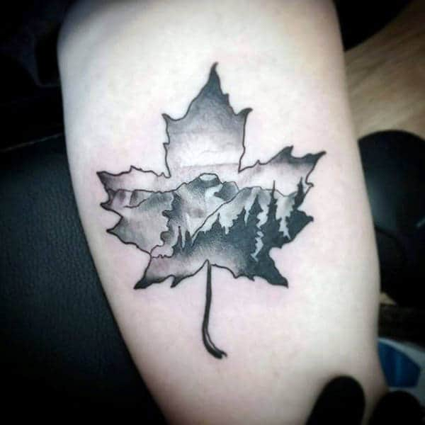Mens Maple Leaf Tattoos With Mountain Nature Background On Arm