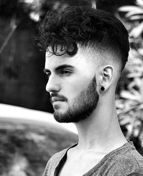 Mens Medium Length Curly Hairstyle With Skin Fade Sides
