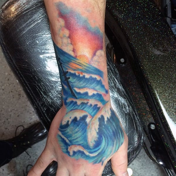 Mens Ocean Waves And Sunset Hand Tattoo In Traditional Style