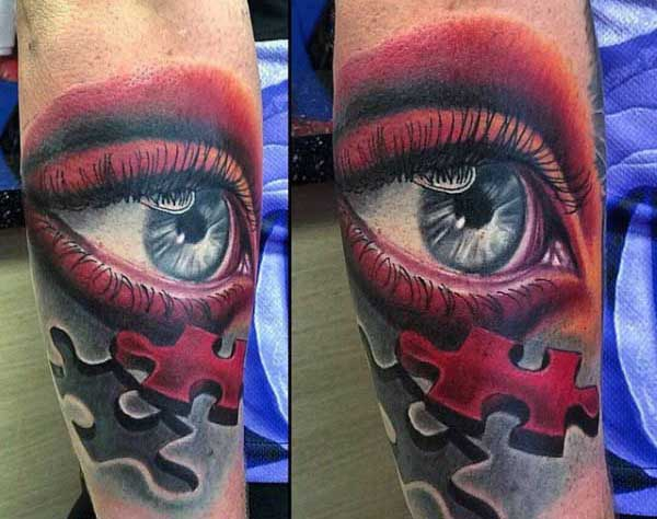 Mens Puzzle Pieces Tattoos Of Red Eye On Outer Forearm