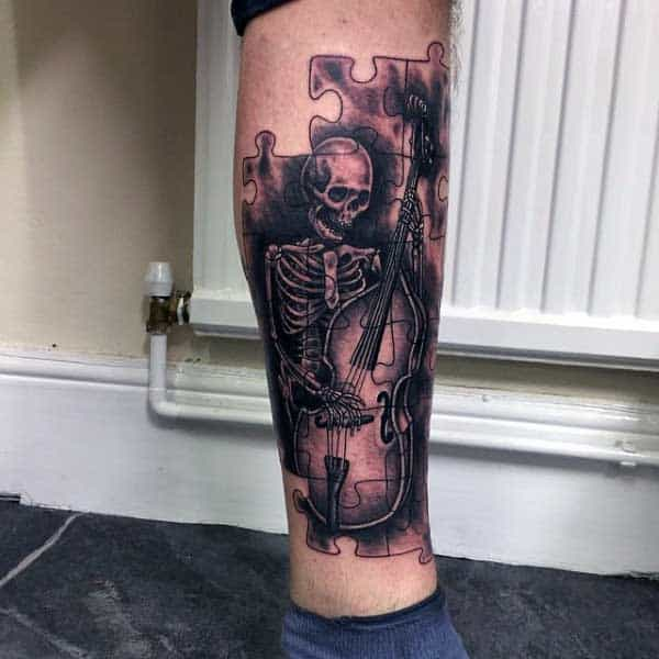 Mens Puzzle Tattoos Of Skeleton Playing Musical Instrument On Legs