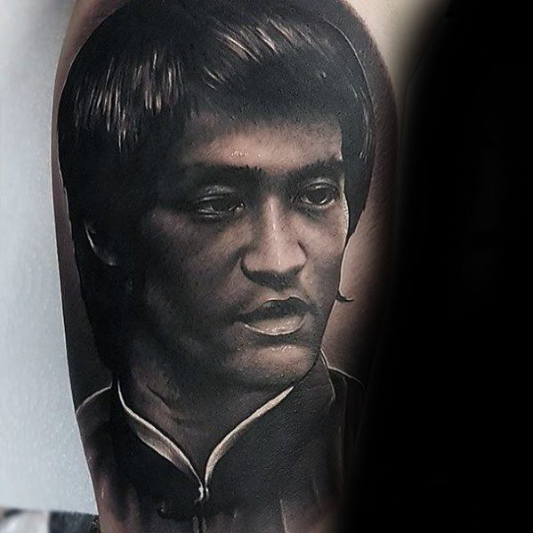 Mens Realistic Arm Portrait Tattoo With Bruce Lee Design