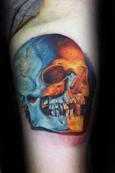 Mens Realistic Skull With Orange And Blue Ink Design On Arm