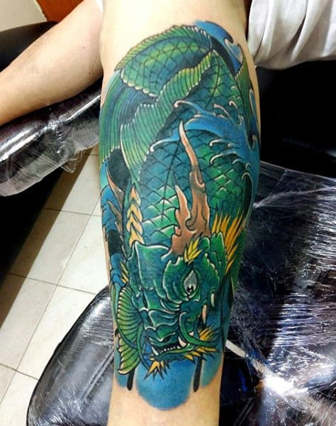 Men's Red Koi Fish Tattoo On Leg