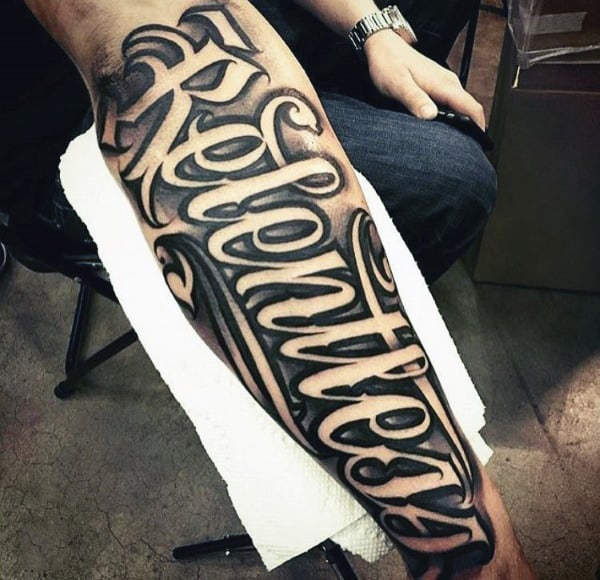 Mens Relentless Script Tattoo On Outer Forearm With Neagtive Space Design
