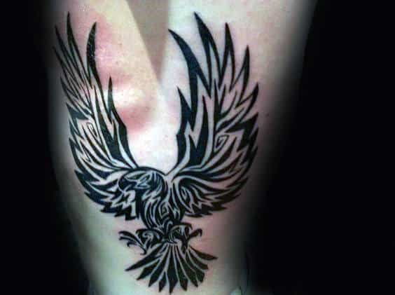 Mens Ribs Tribal Eagle Tattoos With Black Ink Designs