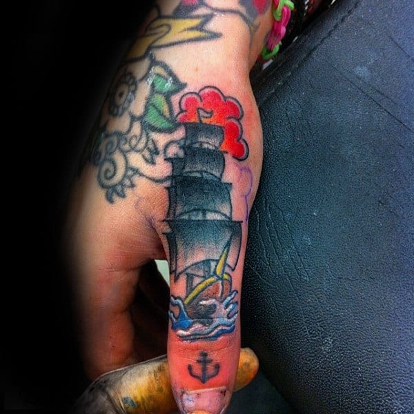 Mens Sailing Ship With Small Anchor Thumb Tattoo
