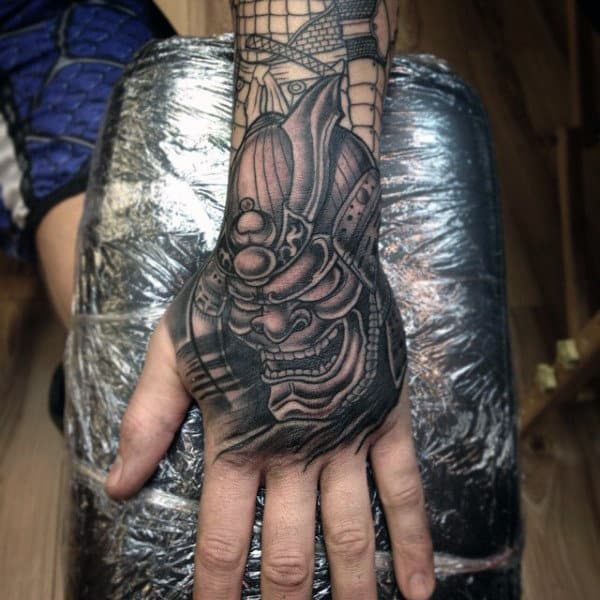 Mens Samurai Mask Shaded Black Work Tattoo On Hand