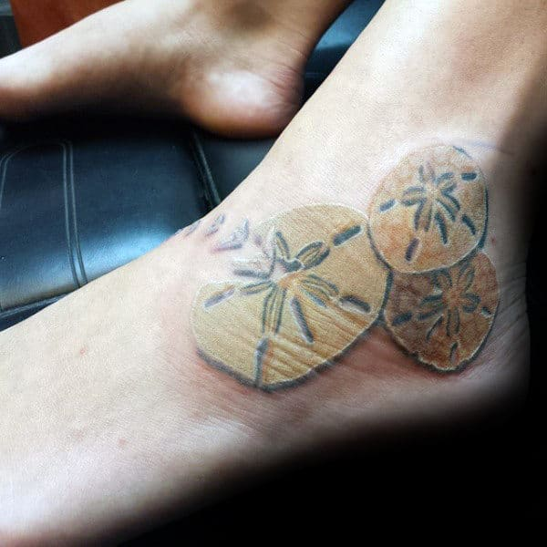 80 seashell tattoo designs for men oceanic ink ideas for Mens foot tattoos