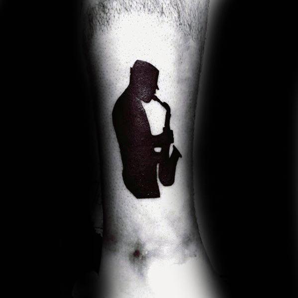 Mens Saxophone Player Silhouette Lower Leg Tattoo