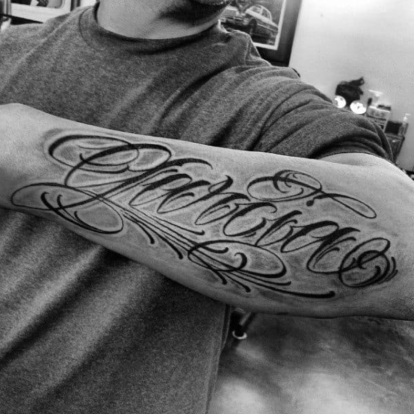 Mens Script Font Last Name Tattoo On Outer Forearm