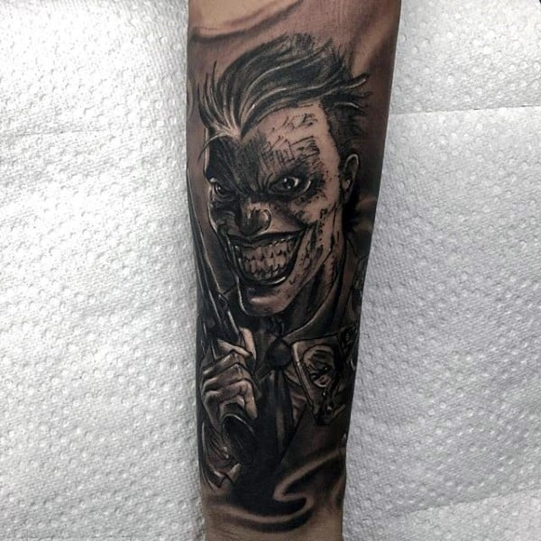 Mens Shaded Black And Grey Ink Sleeve Tattoo On Forearm With Joker Design