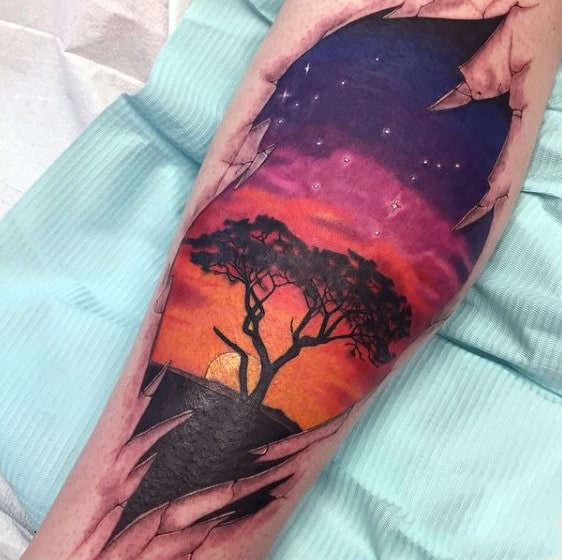 Mens Shin Tattoo African Plains At Sunset Colorful Sky