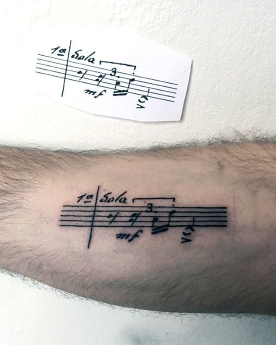 Mens Simple Music Sheet Inner Arm Tattoo