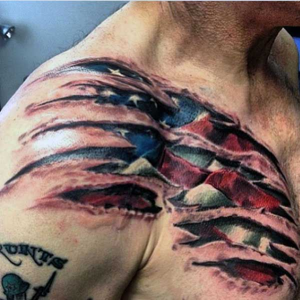 Mens Skin Ripping Tattoos Of American Flag On Shoulder