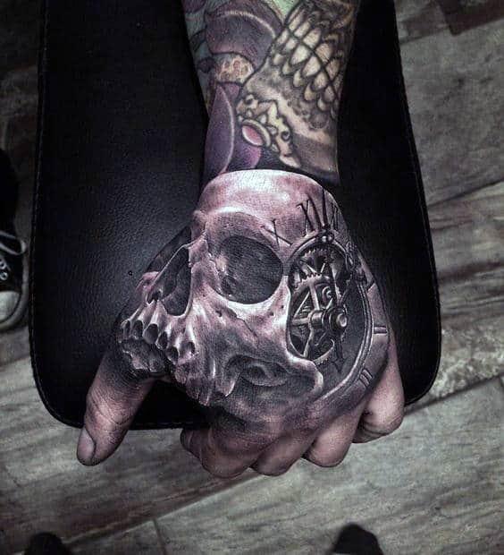 mens-skull-roman-numeral-clock-hand-tattoo