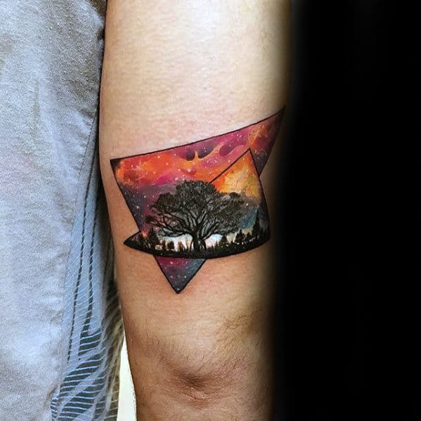 mens-small-outer-space-sky-with-tree-tricep-tattoo