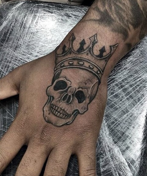 Mens Small Skull With Crown Hand Tattoo