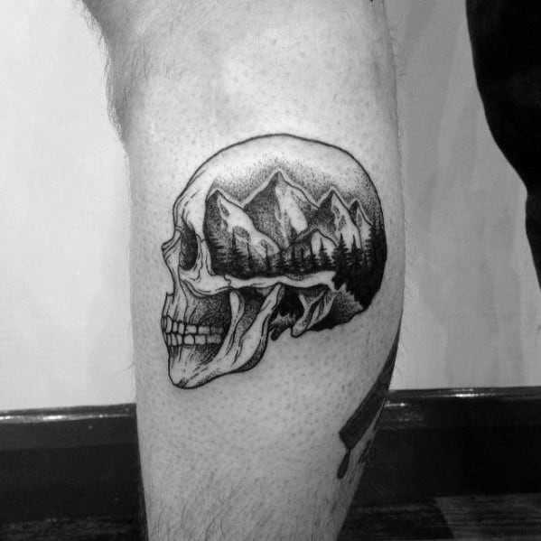 Mens Small Skull With Mountain Landscape Leg Tattoo