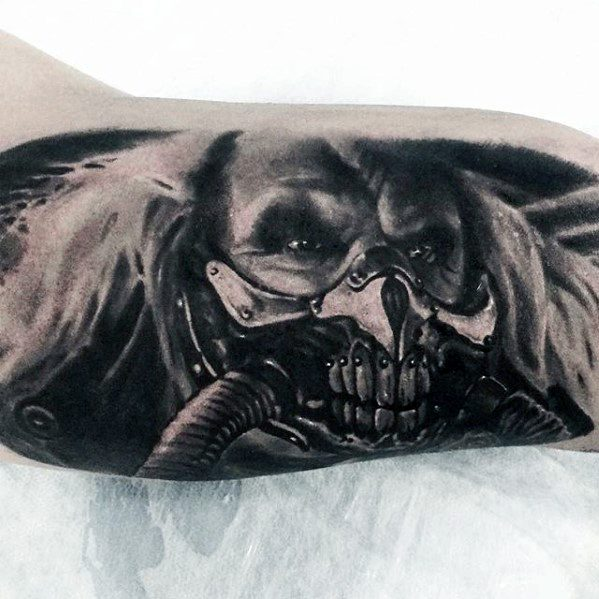 Mens Tattoo Ideas With Mad Max Design On Inner Arm