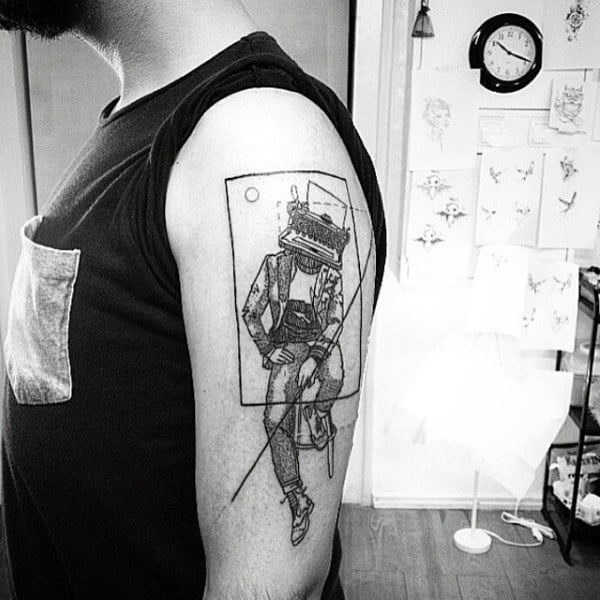 Mens Tattoo Of Figure With Typewriter Head On Arm