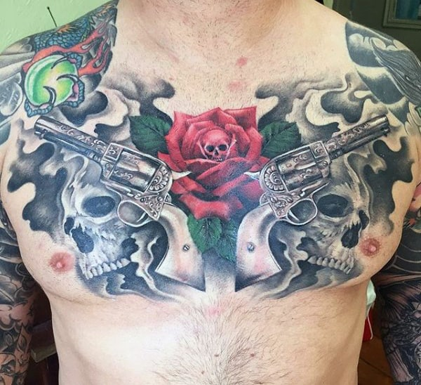 Men's Tattoos Of Gun And Rose On Chest