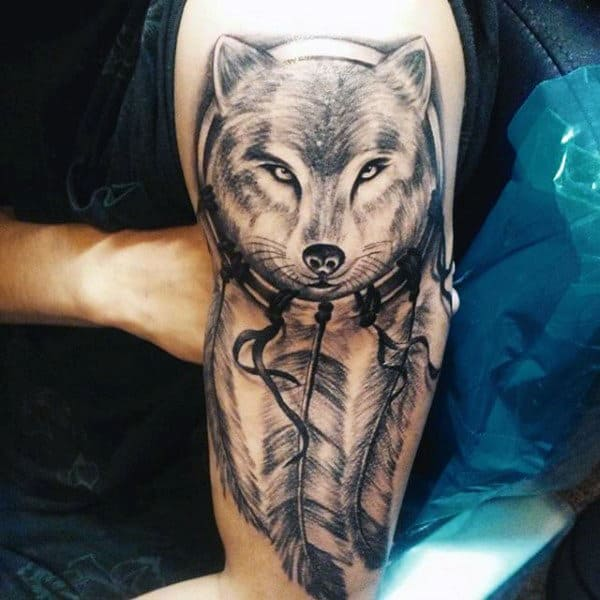 Mens Tattoo On Upper Arm Of Dreamcatcher And Wolf