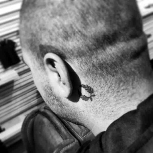 Mens Tattoo With Laurel Wreath Design Behind The Ear