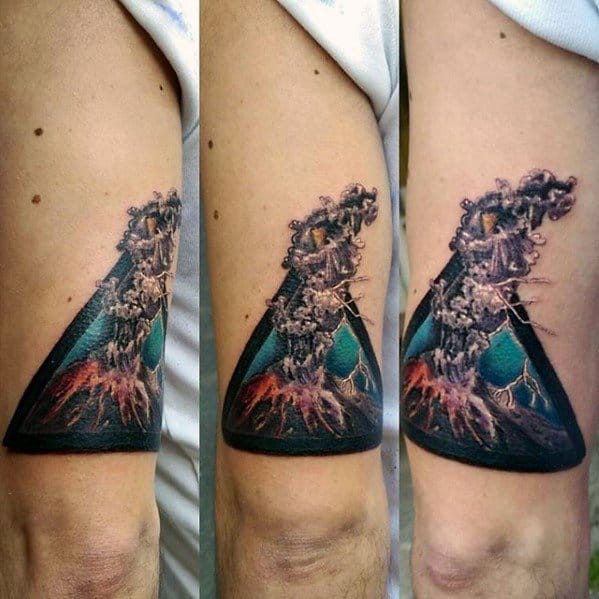 Mens Tattoo With Volcano Design On Thigh