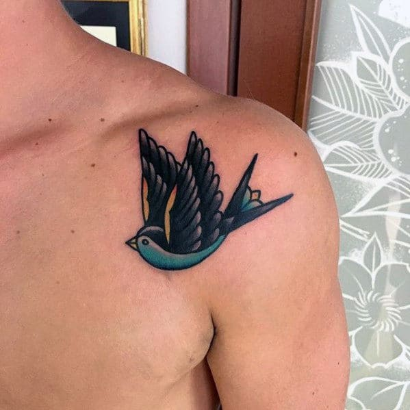 Mens Teal And Black Traditional Flying Swallow Upper Shoulder Tattoo