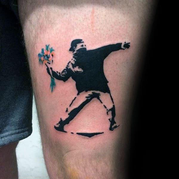 Mens Thigh Banksy Tattoo