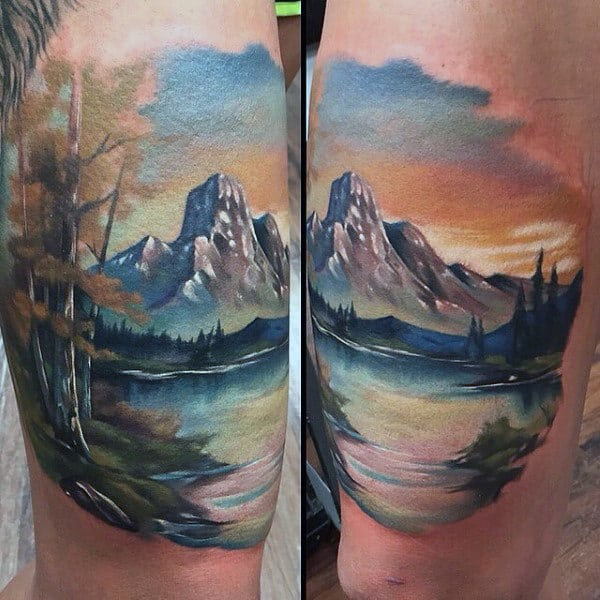 Mens Thigh Tattoo In Watercolor Style Mountainrange And Lake At Sunset