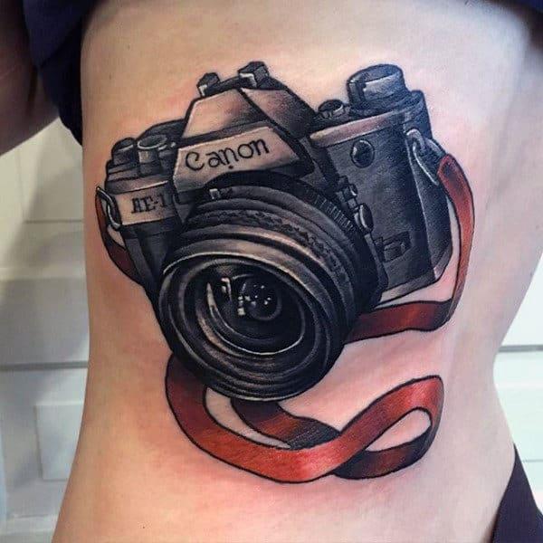 Mens Torso Camera Tattoo With Red Ribbon