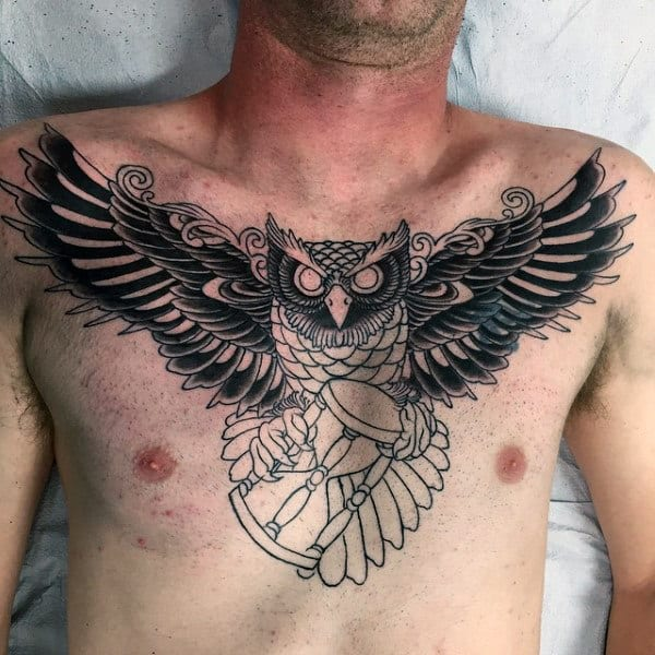 Mens Traditional Tattoo On Chest With Owl Flying With Hourglass