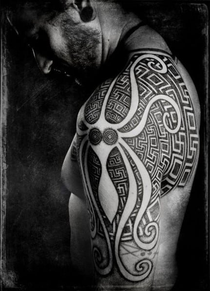 Men's Tribal Tattoo Design On Arm