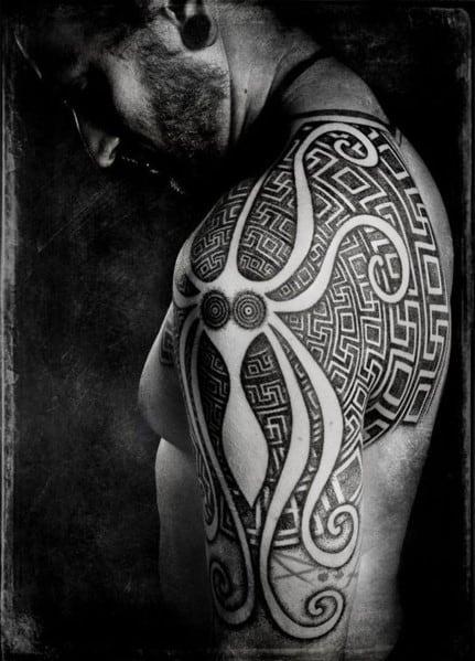 Men's Tribal Tattoo Design On Arm