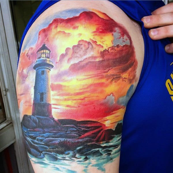 Mens Upper Arm Realistic Sunset Tattoo With Lighthouse