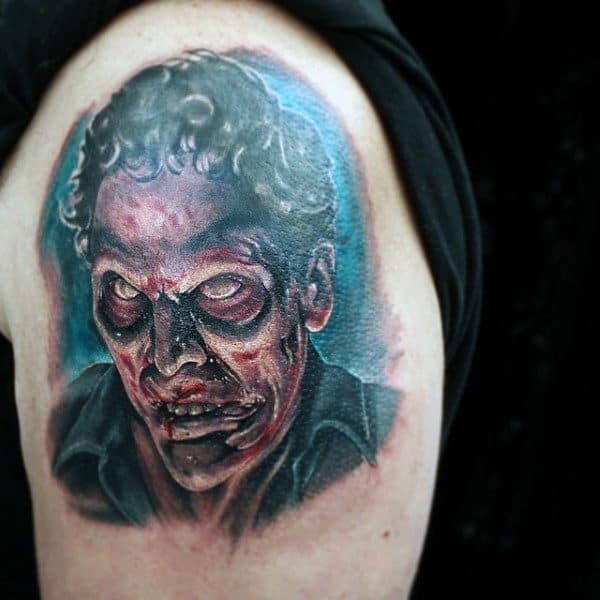 Mens Upper Arm Zombie Tattoo With Shaded Red And Blue Ink
