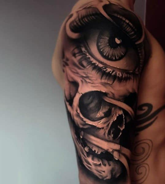 Mens Upper Arms Brown Shaded Eye And Skull Tattoo