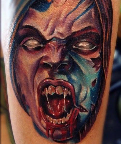 Mens Vampire Teeth Tattoo On Upper Arm